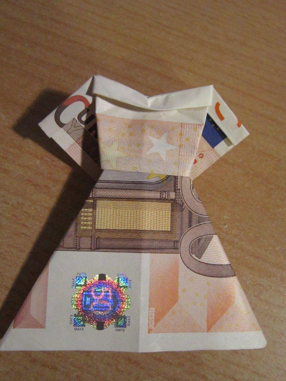 Der Denkende Mensch    Geldwäsche – Kleidung Falten Aus von Geld Zum Hemd Falten Photo