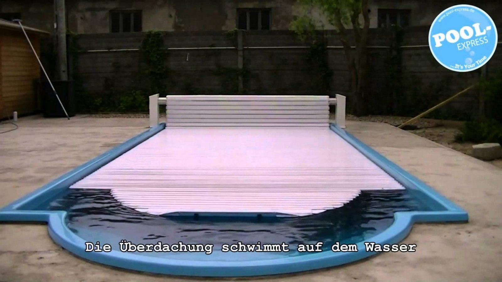Elektrische Schwimmbadüberdachung  Poolüberdachung von Gfk Becken Aus Polen Photo