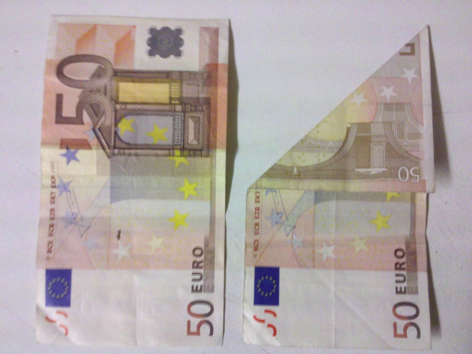 Fisch Aus Einem Geldschein Falten  Origami Mit Geldscheinen von Fisch Aus Geldschein Falten Bild