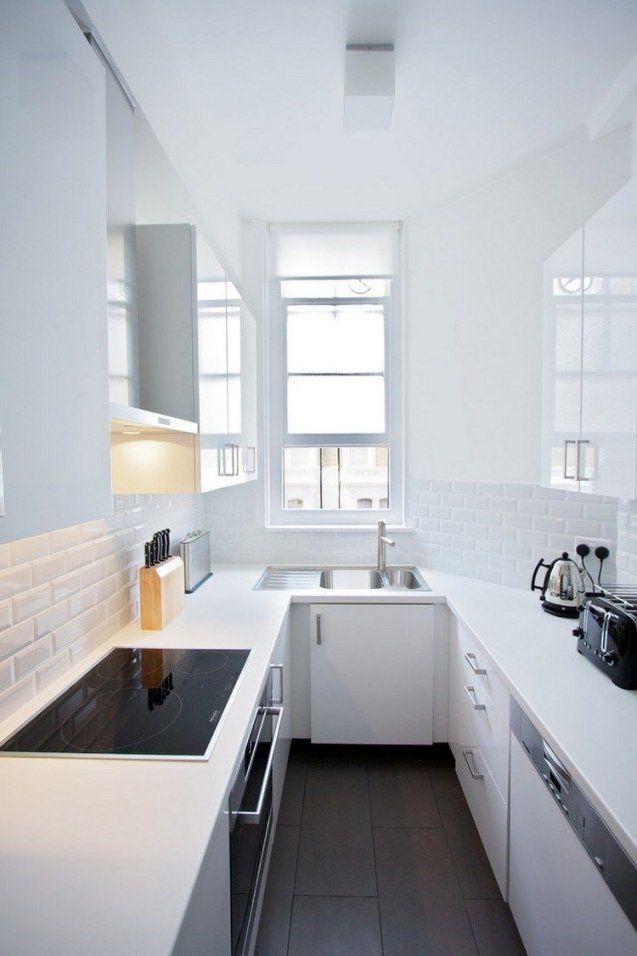 Kleine Uförmige Küche In Weiß Mit Dunklem Bodenbelag  Kitchen von Kleine Küche In U Form Photo